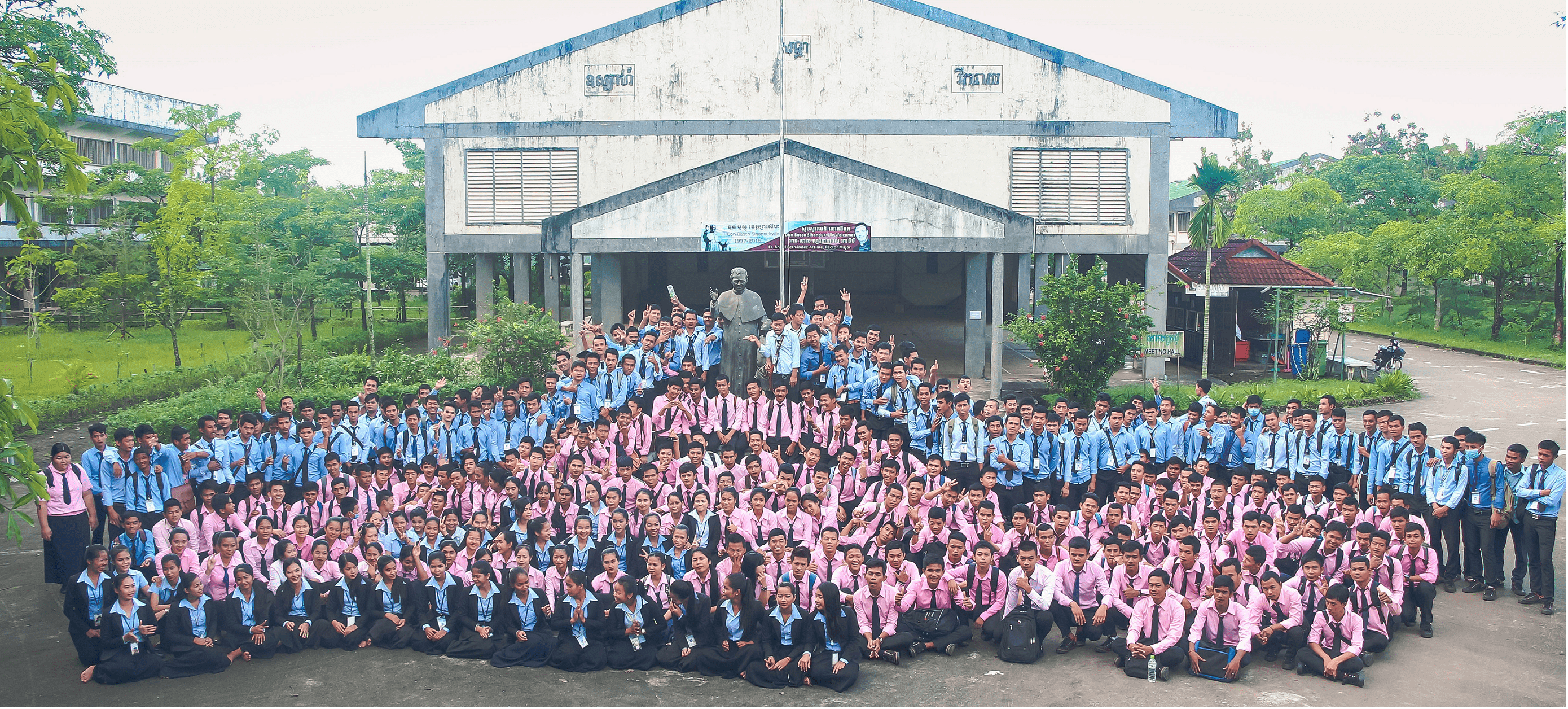 Group photos of TVET students with Don Bosco Statue
